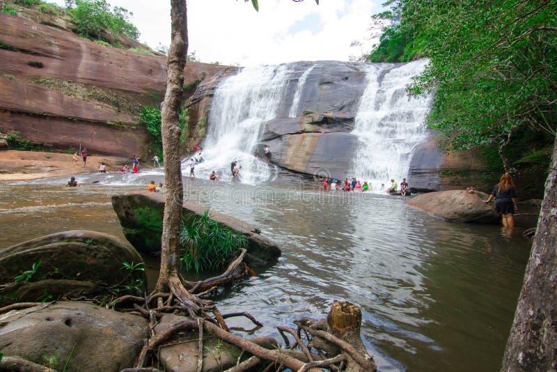 'Chet Si' Waterfall Bungkan thailand. BUNGKAN, THAILAND - August 22, 2015: Unknown person, 'Chet Si' Waterfall, People are playing waterfall. Bungkan 2015 stock photos
