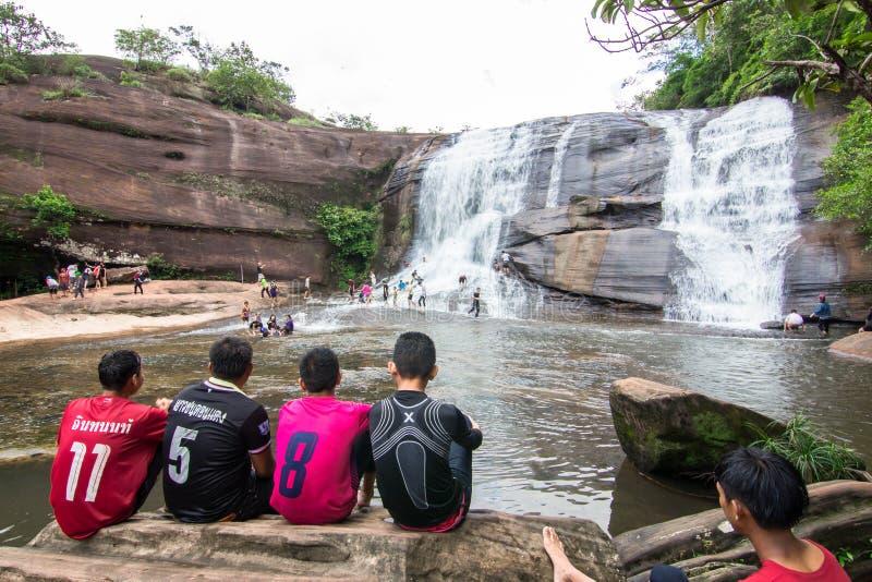 'Chet Si' Waterfall Bungkan thailand. BUNGKAN, THAILAND - August 22, 2015: Unknown person, 'Chet Si' Waterfall, People are playing waterfall. Bungkan 2015 stock image