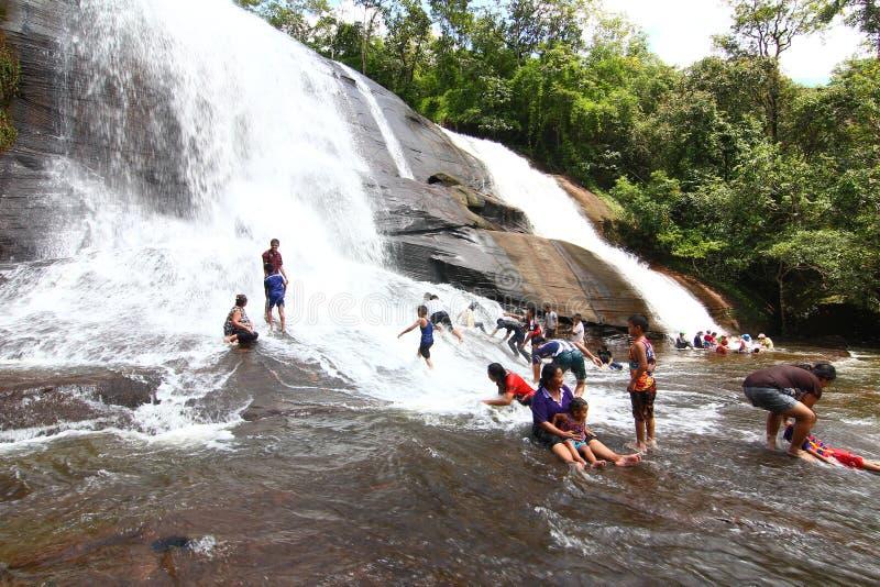 'Chet Si' Waterfall Bungkan thailand. BUNGKAN, THAILAND - August 22, 2015: Unknown person, 'Chet Si' Waterfall, People are playing waterfall. Bungkan 2015 royalty free stock images