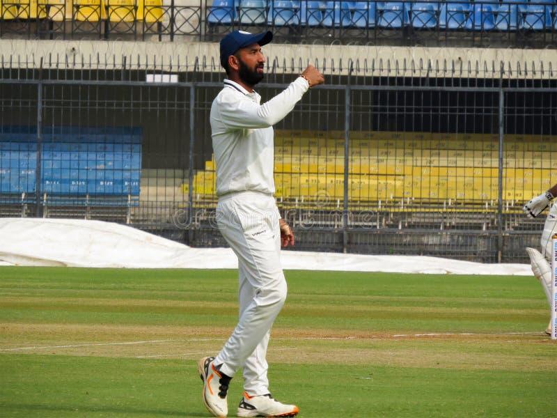 Cheteshwar Pujara Cricketer India. Indian International sportsman player Cheteshwar Pujara in White Uniform. Pujara is a Right-Handed Batsman and he bowls Right royalty free stock photo