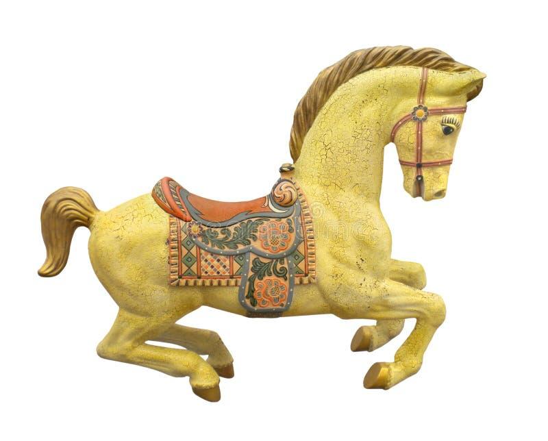 Cheval jaune de carrousel de vintage d'isolement. photographie stock libre de droits