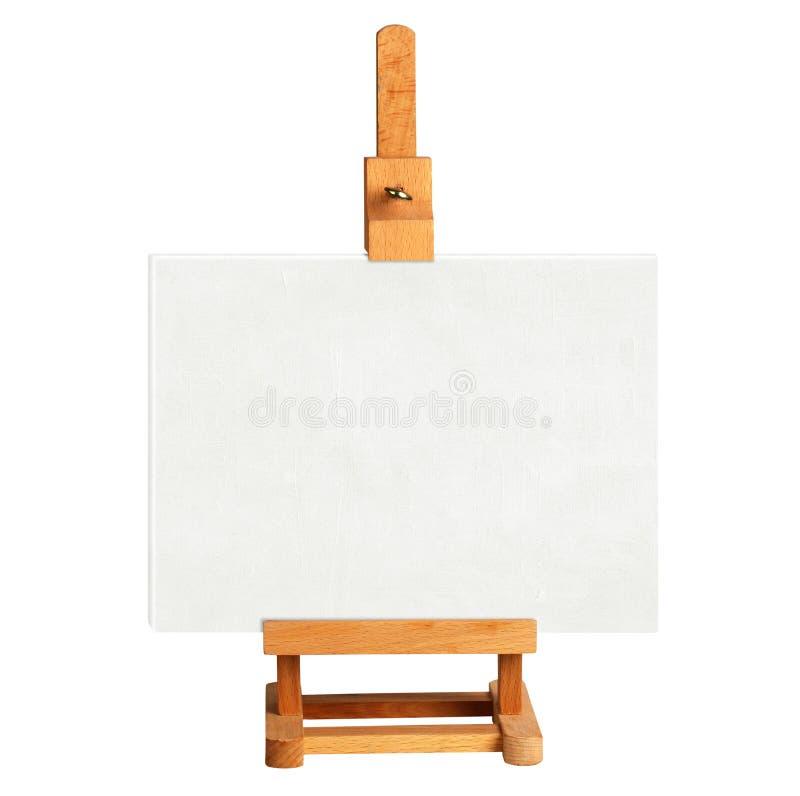 Chevalet en bois avec le conseil vide d'art sur le blanc photo libre de droits