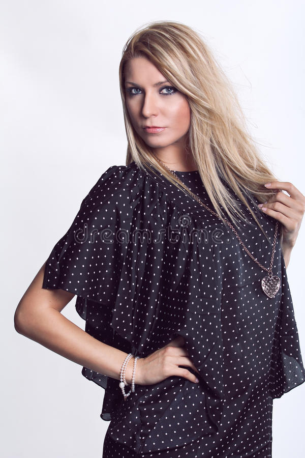 Cheveu blond et œil bleu photo stock