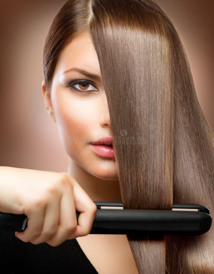 Cheveu redressant des fers photographie stock