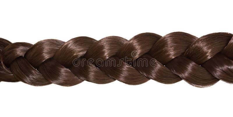 Cheveux du ` s de femmes d'isolement sur le fond blanc Une tresse brune des cheveux photo libre de droits