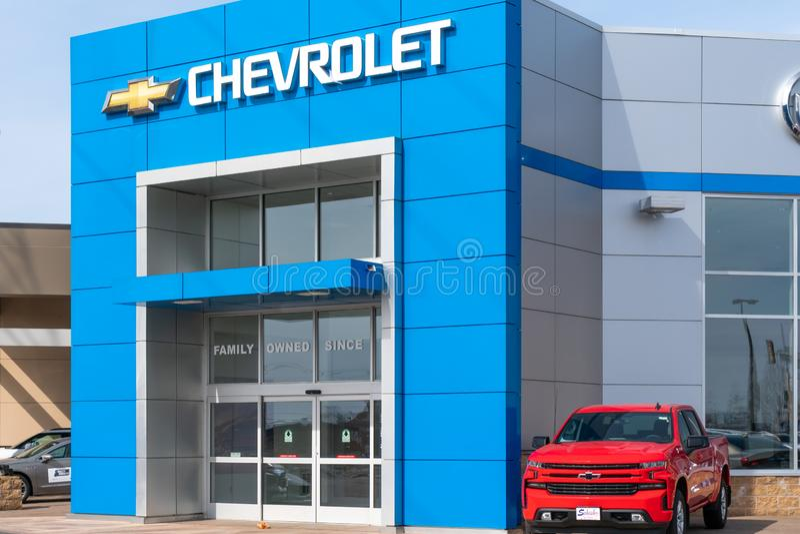Chevrolet-Automobil-Verkaufsstelle und Logo des eingetragenen Warenzeichens stockfotografie