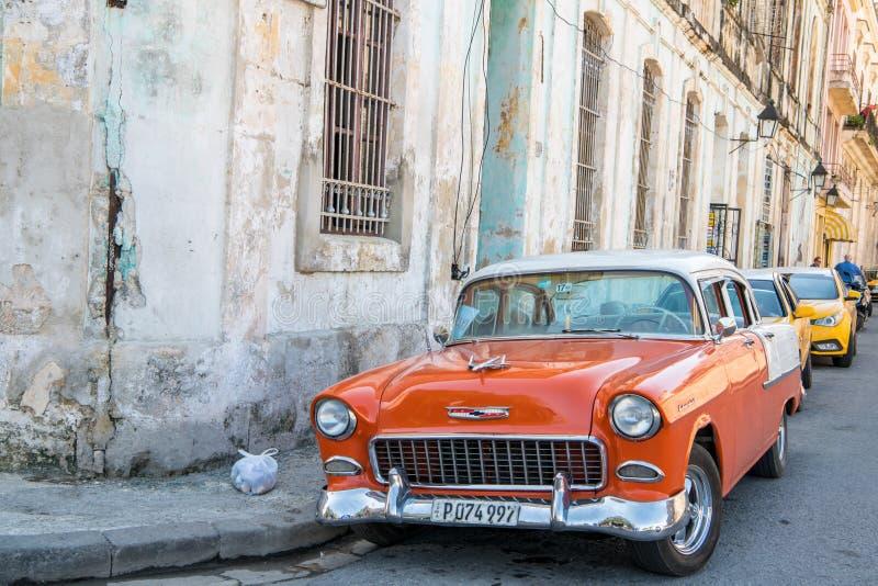 Chevrolet Bel Air, Cuba, orange american classic car, Havana, Cuba. Orange and white colored Chevrolet Bel Air in street of Havana, Cuba stock photo