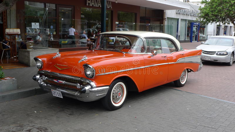 Chevrolet Bel Air 1957. Lima, Peru. April 8, 2012. View of a classic mint condition hard top four doors orange color with white roof Chevrolet Bel Air produced stock photo