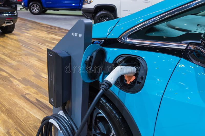 Chevrolet Bolt EV electric car charging on display stock photography