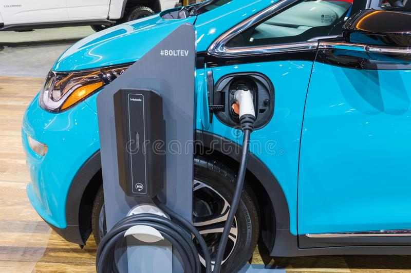 Chevrolet Bolt EV electric car charging on display royalty free stock photos