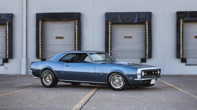1968 Chevrolet Camaro SS. In front of a loading dock royalty free stock photo