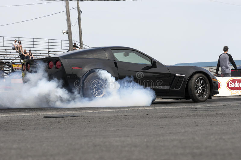 Chevrolet corvette on the track making smoke show stock photos
