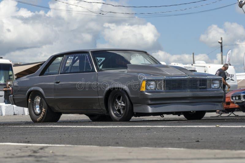 Chevrolet malibu en la pista imágenes de archivo libres de regalías