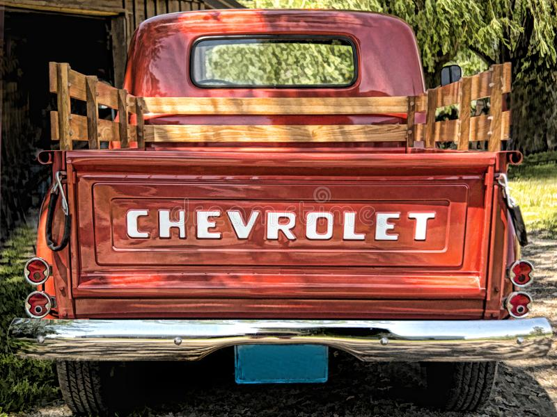 57 Chevrolet pick up truck rear view. 1957 Chevrolet red pick up truck rear view of tailgate with blue license plate royalty free stock photos