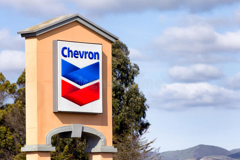 Chevron Gas Station Sign. SALINAS, CA/USA - APRIL 3, 2014: Chevon gas station sign. Chevron Corporation is an American multinational enery corporation royalty free stock photo