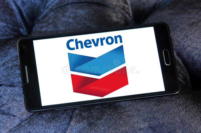 Chevron oil campany logo. Logo of oil company chevron on samsung mobile phone a5 stock images
