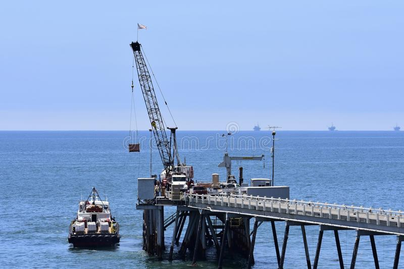 Chevron Oil Pier Carpinteria California, 7. A private pier to get equipment and personal back-and-forth to the off shore oil rigs, it is off limits to public stock photo
