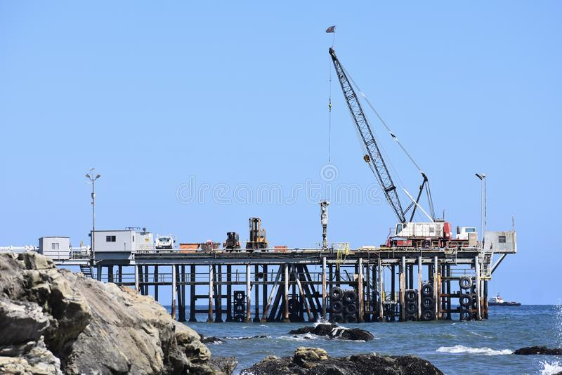 Chevron Oil Pier Carpinteria California, 3. A private pier to get equipment and personal back-and-forth to the off shore oil rigs, it is off limits to public stock photo