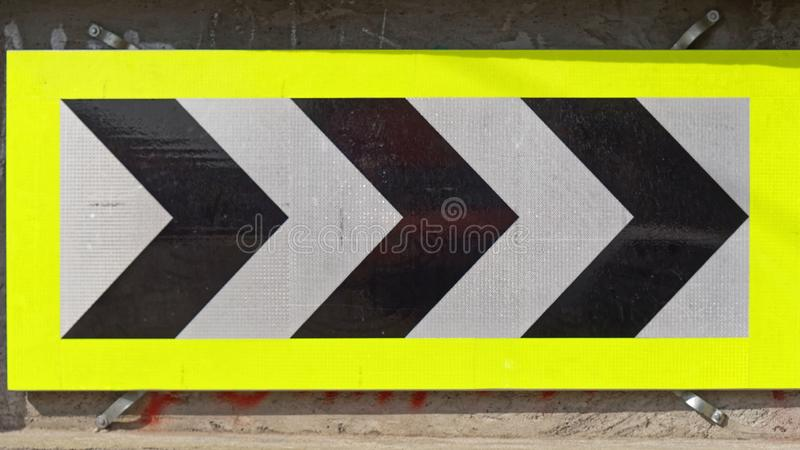 Chevron curve sign. Chevron sharp right curve warning traffic sign arrows stock photos