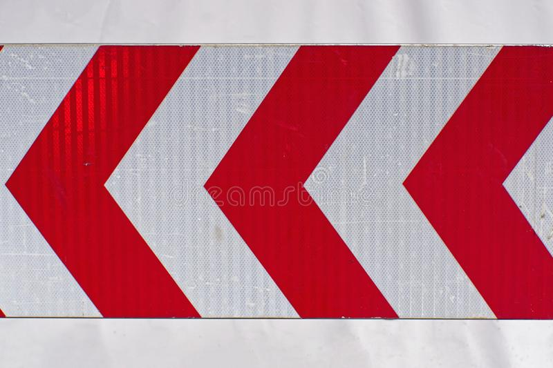 Chevron sign. Chevron warning traffic sign red arrows stock photo