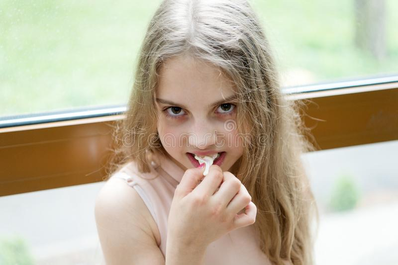 Chew gum to stay numb. Cute little girl chewing a gum. Adorable small child stretching white bubble gum. Protecting stock photos