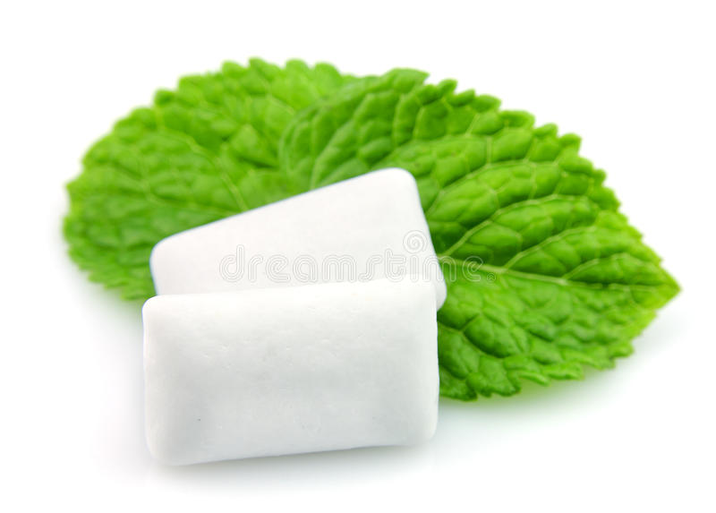 Chewing gum. Fresh leafs mint with chewing gum royalty free stock photos