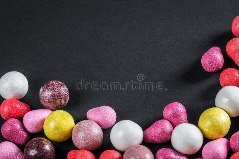 Chewing gum, candy, chewing candy and other sweets. On black background. Focus on black background for your text stock photos