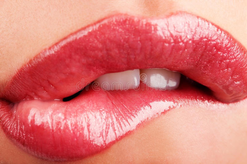 Chewing lips stock photography