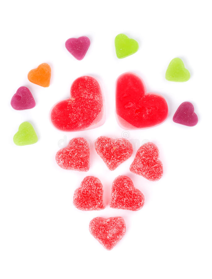 Chewy colored candies in heart shape royalty free stock image
