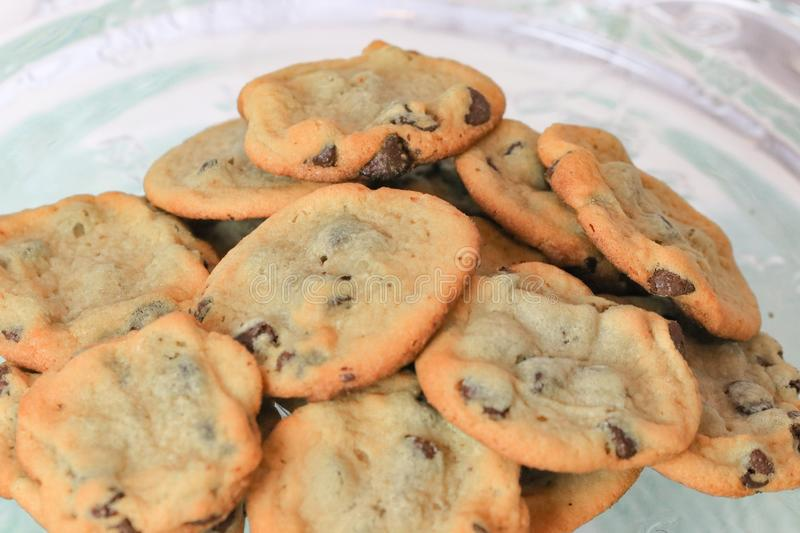 Chocolate chip cookies on a plate. Chewy and crunchy chocolate chip cookies on a glass plate up close royalty free stock images