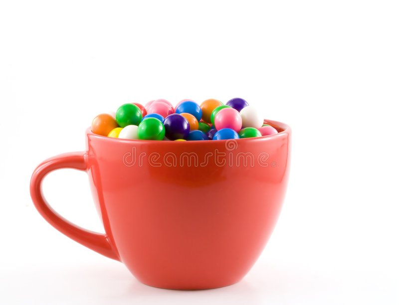 Chewy treats. Chewy gum balls sit in a red coffee cup royalty free stock image