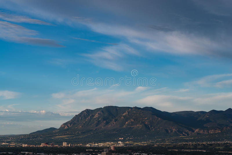 Cheyenne Mountain. Looms over Colorado Springs royalty free stock photography