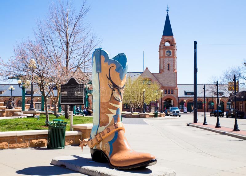 Cheyenne Wyoming downtown district and boot. CHEYENNE, WYOMING - APRIL 27, 2018: View of historic downtown Cheyenne Wyoming with landmark boot sculpture royalty free stock photo