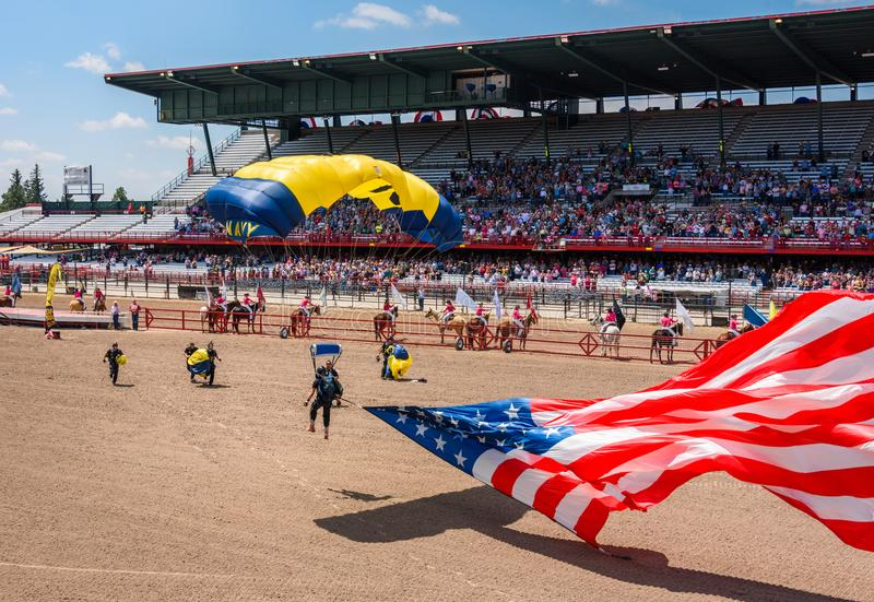 CHEYENNE, WYOMING, USA - JULY 27, 2017: US Navy Leap Frogs team of skydivers opens the annual Frontier Days Rodeo. Carrying the Am stock image