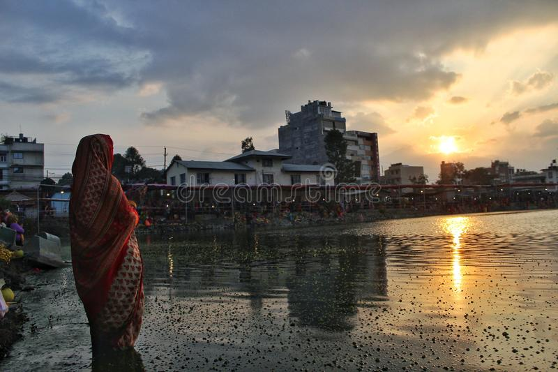 Chhath puja. Performing of prayer to Sun around the holy rivers, ponds and other small water bodies royalty free stock images