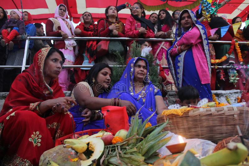 Chhath puja. Women Performing of prayer to Sun around the holy rivers, ponds and other small water bodies stock photo