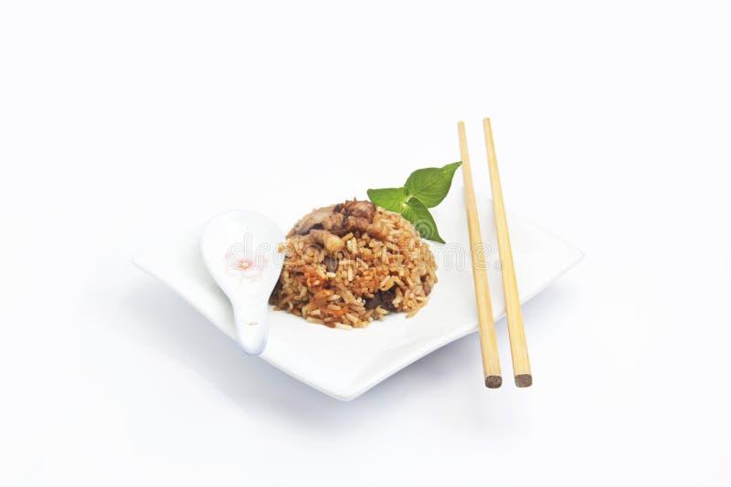Chińczycy smażący ryż z mięsem zdjęcia royalty free
