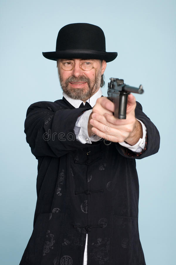 chińczyka pistoletu mężczyzna krótkopędów kostium fotografia stock