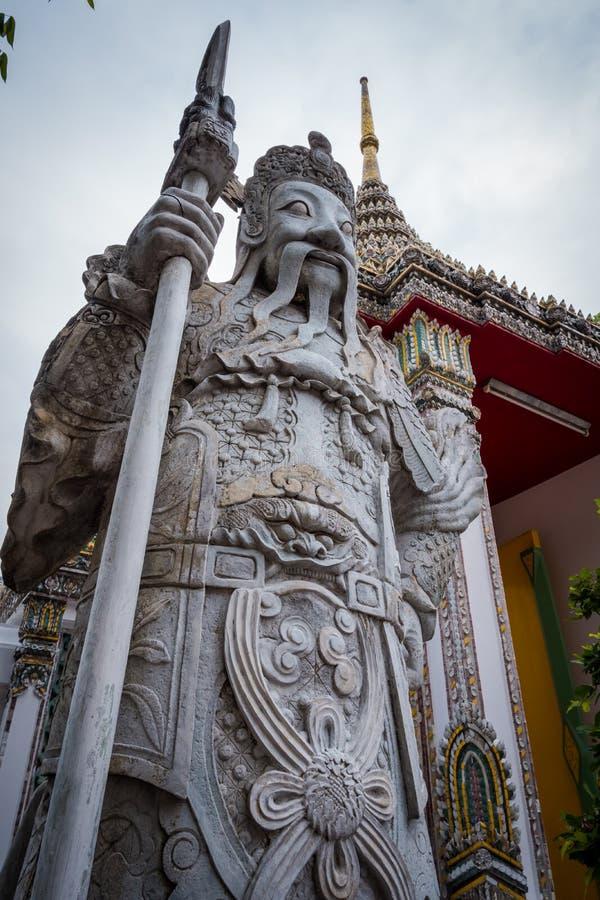 Chińska gigantyczna statua przy Watem Phra Chetuphon Wat Pho lub Wat Phra Chetuphon Vimolmangklararm Rajwaramahaviharn obrazy stock
