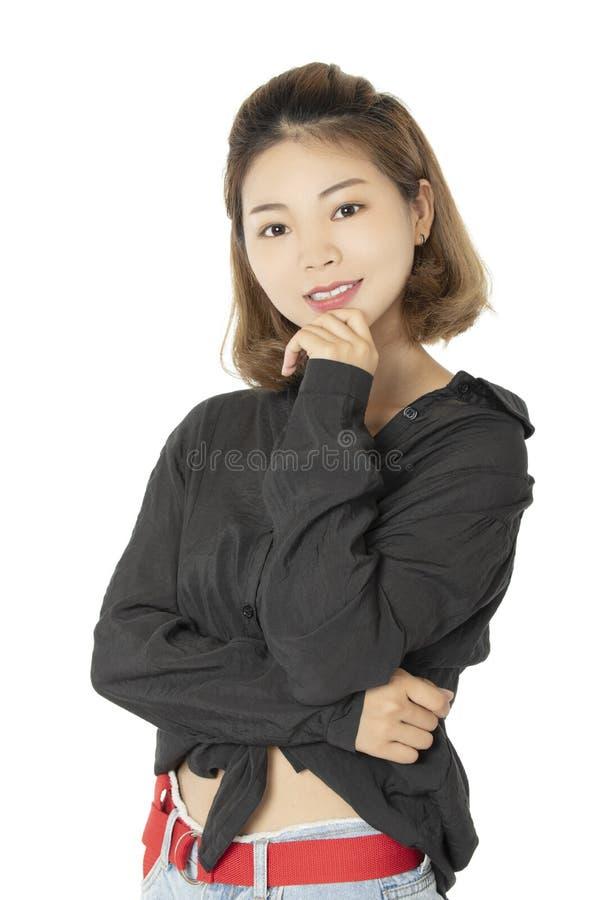 Chińska kobieta ubierał w przypadkowej odzieży odizolowywającej na białym backg obraz stock
