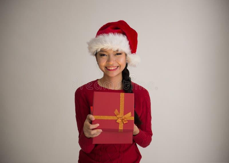 Chiński dziewczyny otwarcia bożych narodzeń prezent obrazy stock