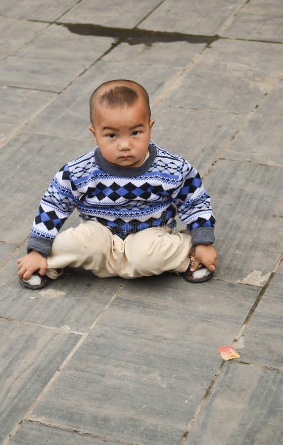 Chiński mniejszościowy dzieciak zdjęcia royalty free