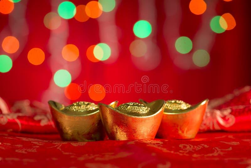 Chińskich nowy rok dekoracj złociści ingots z kopii przestrzenią fotografia stock