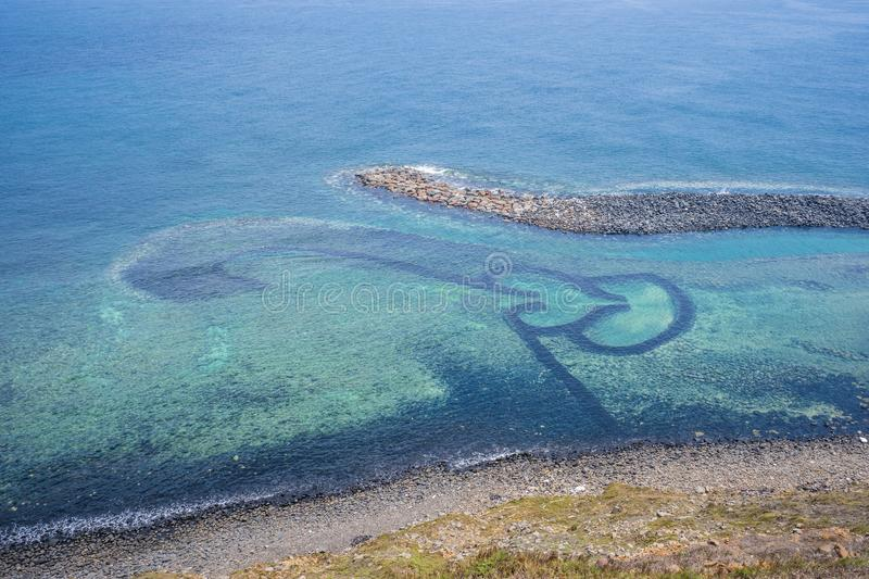 Chi-mei Island is located on the southest side of Penghu Islands in Taiwan.The most famous scenery of Chi-mei Island would be D. Ouble-heart Stone Trap. It was royalty free stock photo