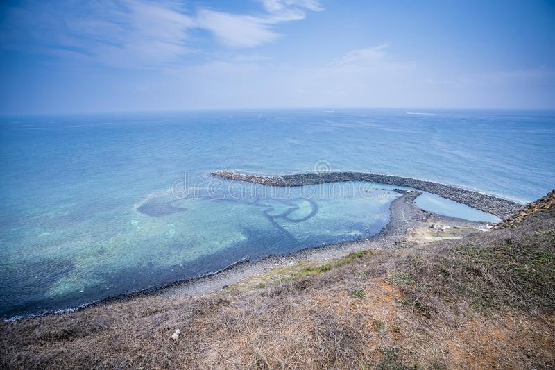 Chi-mei Island is located on the southest side of Penghu Islands in Taiwan.The most famous scenery of Chi-mei Island would be D. Ouble-heart Stone Trap. It was stock photography