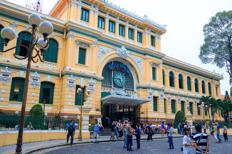 Ho Chi Minh city, Vietnam - December 2018: Central post office of the city at cloudy day with people on the square. royalty free stock images