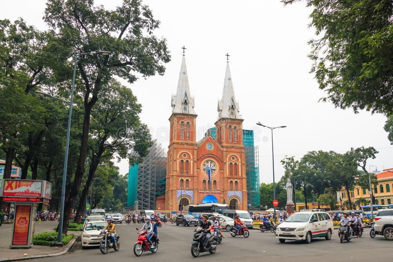 Ho Chi Minh city, Vietnam - December 2018: Notre Dame de Saigon catholic cathedral at cloudy day with square and traffic. royalty free stock photography