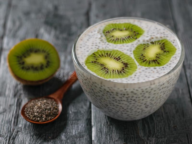 Chia and kiwi seed pudding on a dark rustic table. royalty free stock images