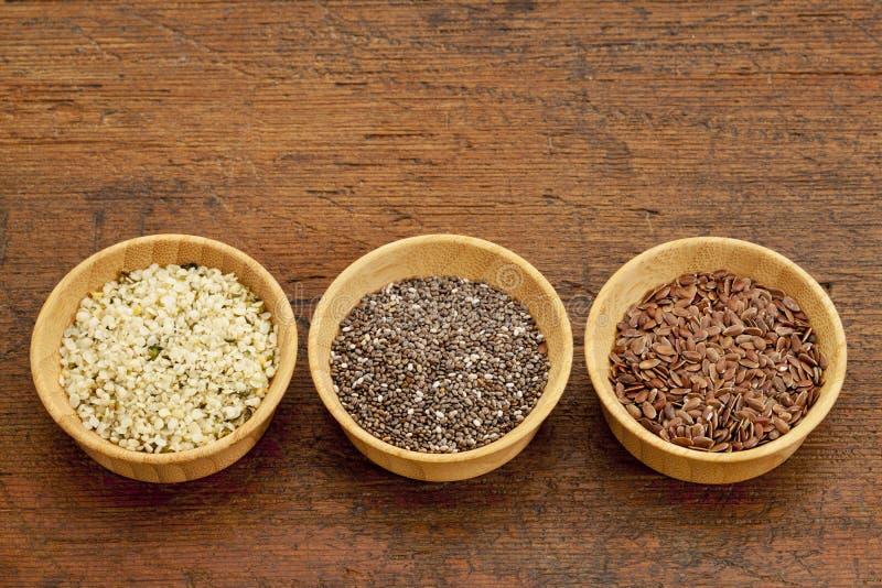 Chia, linho e sementes de cânhamo imagem de stock