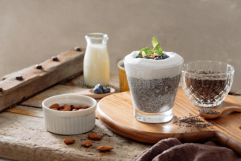 Chia pudding with berries and milk, sweet nourishing dessert, healthy breakfast superfood concept.  stock photo